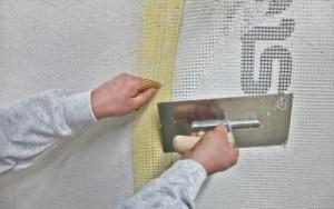 Крепление армирующей сетки к стене