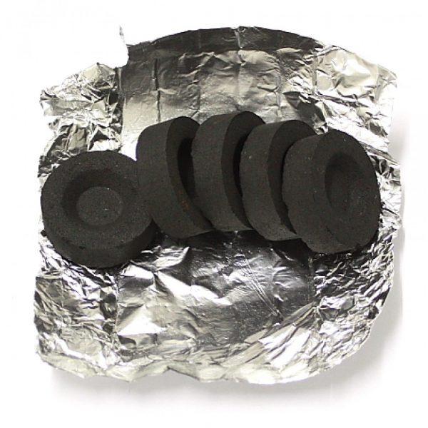 Уголь в форме таблеток на фольге