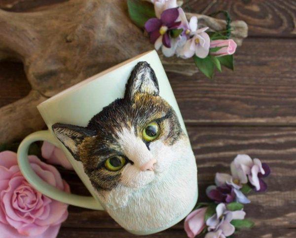 Мордочка котика на кружке